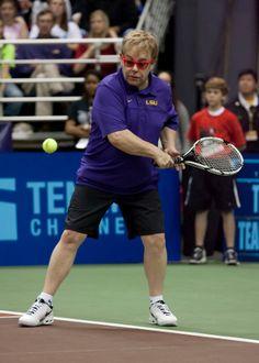 Elton John playing tennis