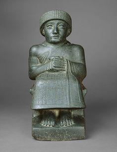 Statue of Gudea -     Period:      Neo-Sumerian  Date:      ca. 2090 B.C.  Geography:      Mesopotamia, probably from Girsu (modern Tello)  Culture:      Neo-Sumerian  Medium:      Diorite