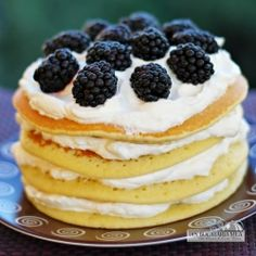 Pancakes with whipped cream and blackberries. My children would worship me.