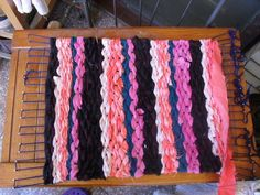 DIY Loom. I think I will make one this afternoon to make rugs on.  Weaving is a much more efficient utilization of resources than knitting or crochet.