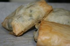 Phyllo Dough, stuffed with Greek Meatloaf, Chopped Spinach, Ricotta Cheese, and Lemon Zest)