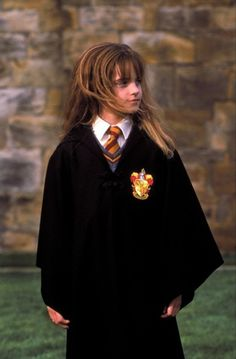 Harry Potter and the Philosopher's Stone, 2001 Costume design: Judianna Makovskylong black wool robe, grey wool v-neck jumper, white shirt and gold & maroon tie - worn by Emma Watson in the role of Hermione