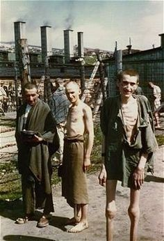 """Survivors in the """"Russian Camp"""" section of Mauthausen. (May 5-10, 1945)"""