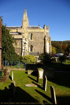 South Churchyard of St Mary the Virgin Church, Dover CT16 1BY, Kent, England, UK. Graveyard of this Church of England parish church is seperated from the church grounds proper by St Mary's Passage that runs this side of the blue railings from Cannon Street (left) to Church Street (right). Originally a Roman site, then probably Saxon. Norman church built between 1066 and 1086. Victorian restoration. Urban Dover Architecture and History photo. More at: http://www.panoramio.com/photo/28024263
