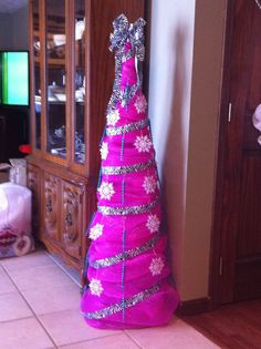 a pink Christmas tree made of deco mesh
