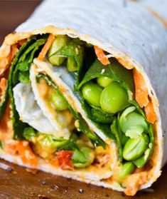 Vegan Hummus Spiral Wrap  This quick sandwich is packed with spinach, edamame, avocado, and carrots. What more could a girl ask for? Prevent lunchtime boredom without any extra effort by using different flavored hummus throughout the week.