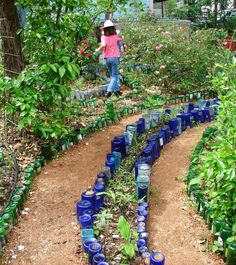 line garden beds and paths with recycled wine or other glass bottles