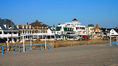 "<a href=""http://www.travelchannel.com/interests/beaches/articles/cape-may-new-jersey"">Cape May,</a> the crown jewel and southernmost point of the Jersey Shore, is dotted with gingerbread Victorian houses and colorful bed and breakfasts. Founded in 1620, this town -- the nation's oldest seashore resort -- is one of few places where the sun both rises and sets over the water."