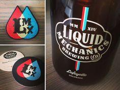 Liquid Mechanics Swag by Emrich Co. logo
