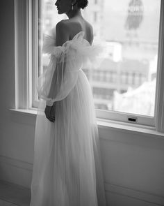 Tulle wedding dress with ruffles and long sleeves | Pin discovered by Kelly's Closet bridal boutique in Atlanta, Georgia
