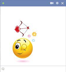 Cupid emoticon with love arrow.