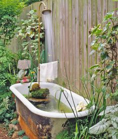Recycle that claw bathtub! Make a Garden Shower Pond out of it!  Architectural Salvage: Tips for Finding and Reusing Vintage Pieces garden tub, water features, clawfoot tubs, fountain, watering cans, vintage bath, wildlife garden, herbs garden, garden shower