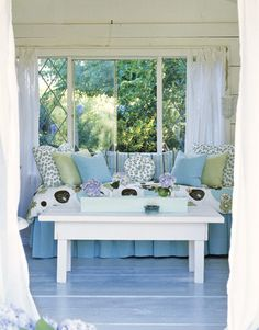 Love these blues and greens with the white wood. This looks like the perfect spot for curling up with favourite decorating mag.s and a cup of tea.