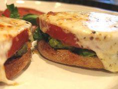 avocado tomato mozzarella cheese sandwich.