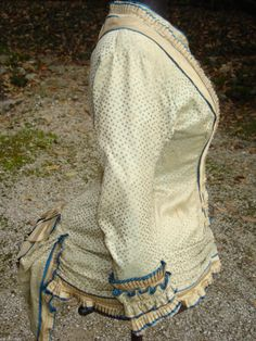 1870s extant French bodice off ebay. Basque bodice rides low over hips, bow at bottom instead of at waist.