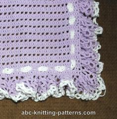 "ABC Knitting Patterns - Baby Blanket with Double Ruffle. Size: 32 x 32"" (82 x 82 cm) G hook plus 3 skeins of baby sport wt yarn     free pattern"