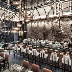 Copper is used throughout this restaurant inside a nineteenth-century explosives magazine in Hong Kong designed by interiors company WANG, which is based in the same city #Inside Awards 2013