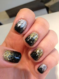 black gel with gold and silver glitters. nail art