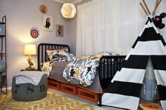 """A new big-boy room. It's not a huge room, so organization is key. We have created a few """"mini-stations"""" designed to make the room as functional as possible. The space is designed to grow as Finn does."""