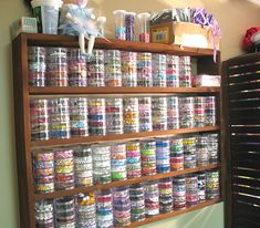 Wow! So many beads stored on wall shelving! tower, colors, wall shelving, bead storage ideas, craftroom, seed beads, jewelry studio, crafts, craft rooms