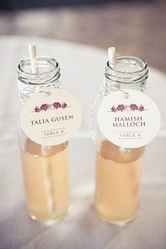 seating cards attached to a cocktail for the guests