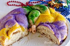 King Cake - definitely not what I expected and completely delicious!  Traditional, it's flaky and layered like a cinnamon roll, very moist, with frosting and purple-green-yellow sugars.  Delicious!!