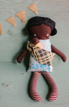 dollie with baby and sling set.