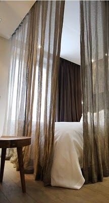 Curtains around the bed, hang from ceiling,very romantic.