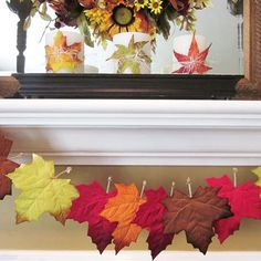 Spice up ordinary candles with faux leaves. More fall mantel decorating: http://www.bhg.com/thanksgiving/decorating/fall-mantel-decorating-ideas/?socsrc=bhgpin101413leafgarland&page=15