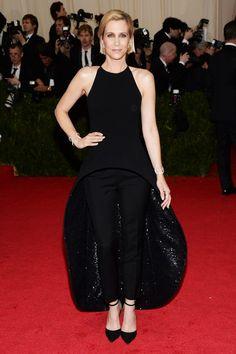 Kristen Wiig wore a Balenciaga by Alexander Wang dress and trousers.