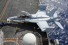 Sailors transport an EA-18G Growler assigned to the Gauntlets of Electronic Attack Squadron (VAQ) 136 onto an aircraft elevator aboard the aircraft carrier USS Ronald Reagan (CVN 76) 140620-N-OC010-101 PACIFIC OCEAN (June 20, 2014) Sailors transport an EA-18G Growler assigned to the Gauntlets of Electronic Attack Squadron (VAQ) 136 onto an aircraft elevator aboard the aircraft carrier USS Ronald Reagan (CVN 76). #AircraftCarrier #ReaganCVN76