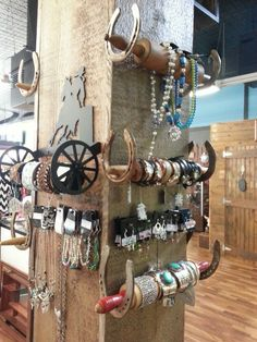 Rolling pins and horse shoes make an awesome jewelry display at my store A Country Girls Way!!! western store display, shoe display, hors shoe
