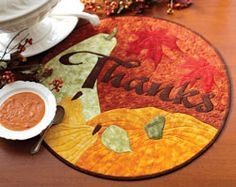 Thanks from Quilting Celebrations Fall 2013 can be used as a quilted table topper or quilted wallhanger and features appliqué pumpkins, pears, and oak leaves.