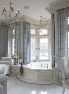 .I love the way the wood cornices & draperies are done. So much more practical & realistic than all these photos you see of uncovered windows over a tub. Seriously, would any woman bathe at night knowing anyone could see in?