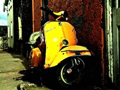 Well loved yellow Vespa.