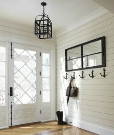 Love the paneling on the walls & the front door