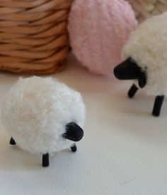 Easy Pompom Sheep-- Chunky yarn these are Homespun by Lion Brand, white)     Piece of cardboard (3x5 for the sheep or 3x1.5 for the lamb)     Packing tape     Scissors     Waxed twine     Floral wire     Black polymer clay     tacky glue