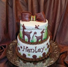 Bambi cake inspired by Willow Nursery Bedding set. Pink bow and pink base icing instead with brown Happy 1st Birthday Willow on bottom tier?