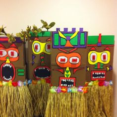 Made these for rugby luau. Stacked 3 wine boxes and taped them together. Painted them. Cut shapes from foam sheets bought at dollar store craft section. Grass skirt glue gunned on. Red eyes blink and are  From dollar store pet section. Dog bone shaped lights for your dogs collar at night.
