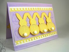 And it's bunny butts! With puff ball tails!  All in a row on this yellow and purple handmade Easter card.