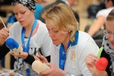 Moms and families of Olympians get creative at the P&G Family Home decorating traditional Russian Matryoshka dolls during the Sochi 2014 Olympic Winter Games.