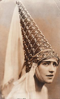 Supreme Cone Head of United Cone Heads Union - - -   Headwear worn by Venetian ladies in the 15th century.Also worn throughout France, England, and other Northern European countries, not just in Venice.