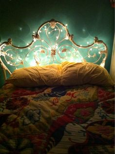 Fairy lights as back light to bed.