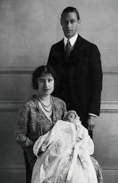 King George VI and Queen Elizabeth, the Queen Mother, cradle the newbornwho would go on to become one of the country's most enduring Queens