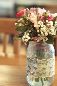 vintage tea party wedding - lace around jar, pink ribbon tying the flowers