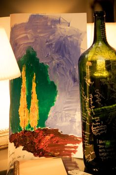 Guest Book - an 18 litre custom wine bottle and gifted painting from Father Bruno