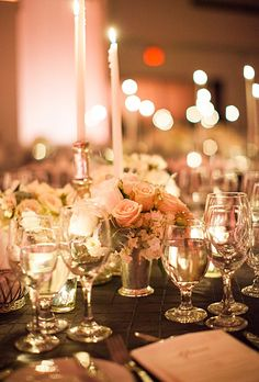 """Brides.com: A Spectacular Fall Wedding in New York City. """"Our centerpieces were touches of white, cremes and light blush blooms,"""" Jacqueline says of the array of arrangements displayed atop each table. Between flowers in mint julep cups and mercury glass sat hundreds of candles."""