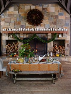 an outdoor fireplace which becomes the entire room of an outdoor living space