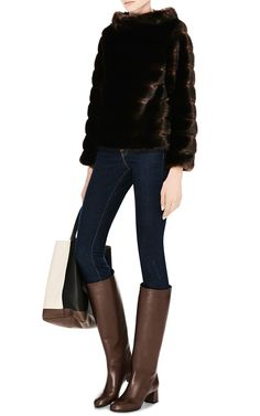 Jeans and boots, and fur. M'O Exclusive: Faux Fur Pullover Top by Harvey Faircloth