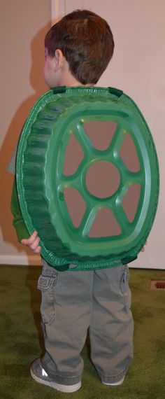 """DYI turtle shell costume for children. Just need a disposable roasting pan, spray paint, felt,and Velcro. ( I cut a sheet of felt into two thin strips and used Velcro to make the straps which criss crossed in the front and made a """"X"""" shape on his chest)"""